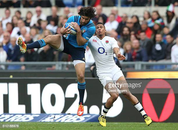 Luke McLean of Italy takes a high ball under pressure from Anthony Watson of England during the RBS Six Nations match between Italy and England at...