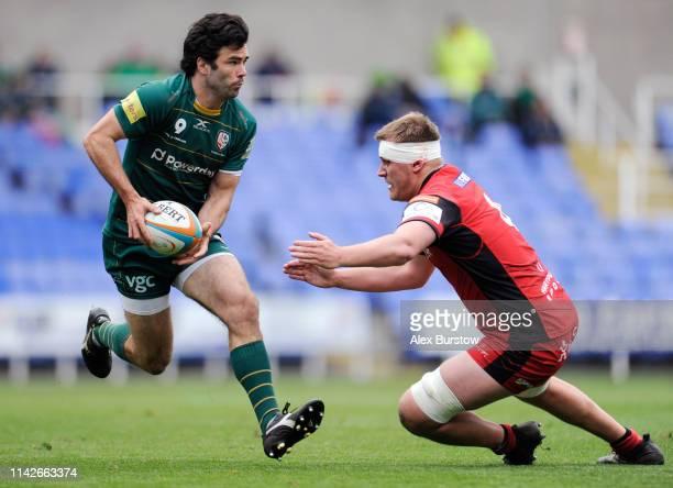 Luke McLean of London Irish is tackled by Joe Batley of Hartpury during the Greene King IPA Championship match between London Irish and Hartpury RFC...