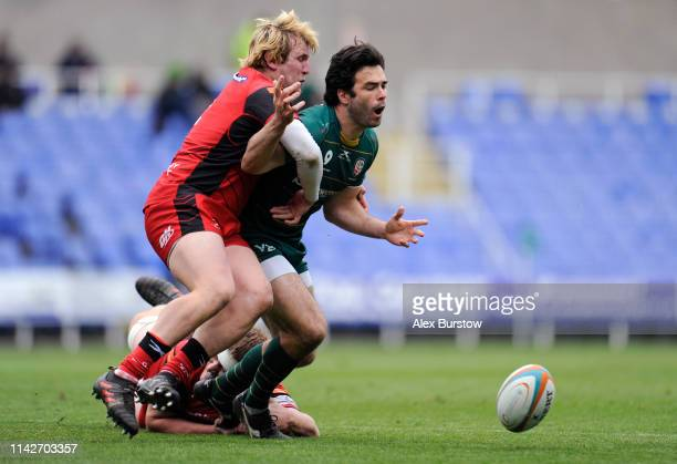 Luke McLean of London Irish is tackled by Luke Stratford and Joe Batley of Hartpury during the Greene King IPA Championship match between London...