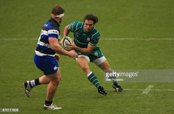 Luke McLean of London Irish runs at Nick Auterac of Bath during the AngloWelsh Cup between London Irish and Bath at Madejski Stadium on November 4...