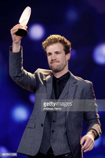 Luke Mockridge poses with his award for best comedian on stage at the 21st Annual German Comedy Awards at Studio in Koeln Muehlheim on October 24...