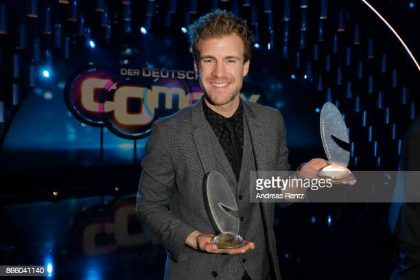 Luke Mockridge poses with his awards for 'Best Comedy Show and Best LiveAct' during the 21st Annual German Comedy Awards on October 24 2017 in...
