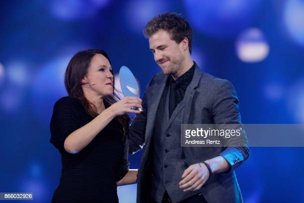 Luke Mockridge receives his award by Carolin Kebekus during the 21st Annual German Comedy Awards on October 24 2017 in Cologne Germany