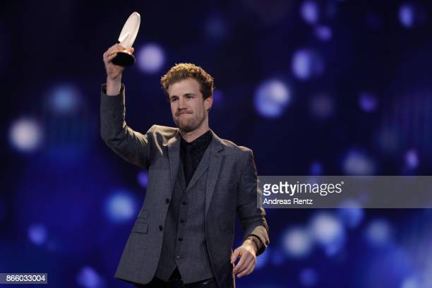 Luke Mockridge receives his award during the 21st Annual German Comedy Awards on October 24 2017 in Cologne Germany