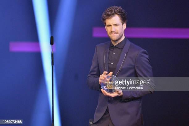 Luke Mockridge speaks on stage at the 1Live Krone radio award at Jahrhunderthalle on December 6 2018 in Bochum Germany