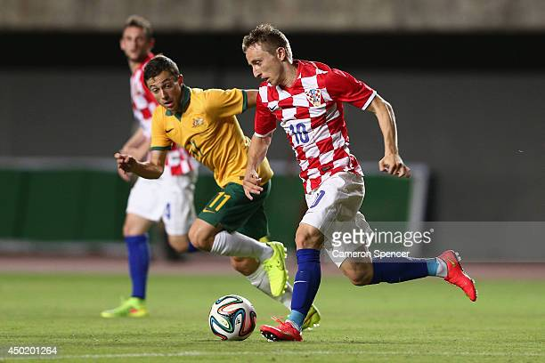 Luke Modric of Croatia controls the ball ahead of Tommy Oar of the Socceroos during the International Friendly match between Croatia and the...