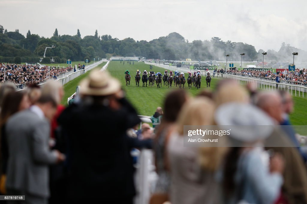 Luke Morris riding Desert Law (C, white) win The Symphony Group Stakes at York racecourse on August 23, 2017 in York, England.