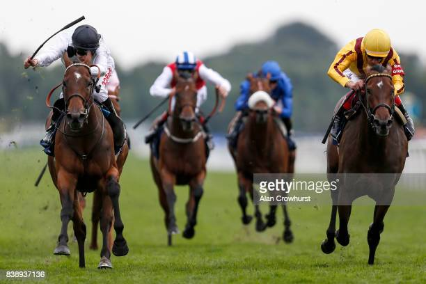 Luke Morris riding Marsha win The Coolmore Nunthorpe Stakes from Lady Aurelia and Frankie Dettori at York racecourse on August 25 2017 in York England