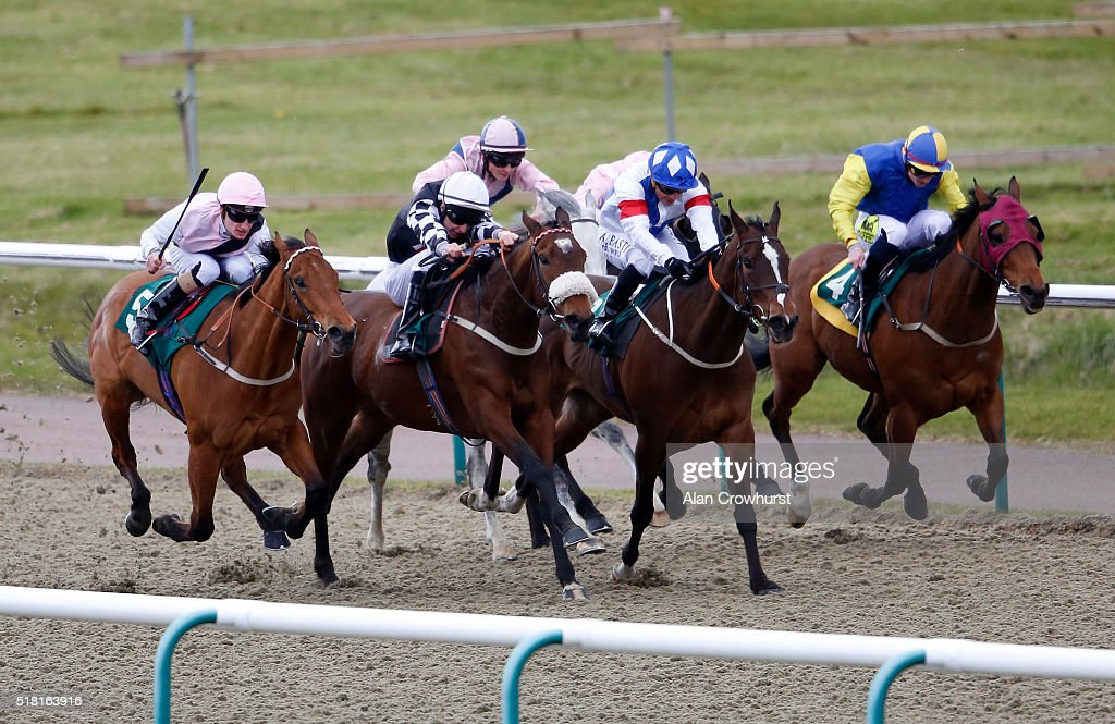 Luke Morris riding Venus Grace (2L, black) win The Racing Welfare handicap Stakes at Lingfield racecourse on March 30, 2016 in Lingfield, England.