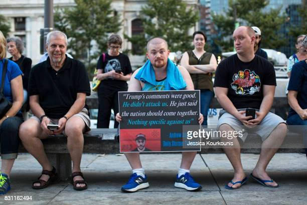 Luke Mueller center attends a vigil in downtown Philadelphia on August 13 2017 in support of the victims of violence at the 'Unite the Right' rally...
