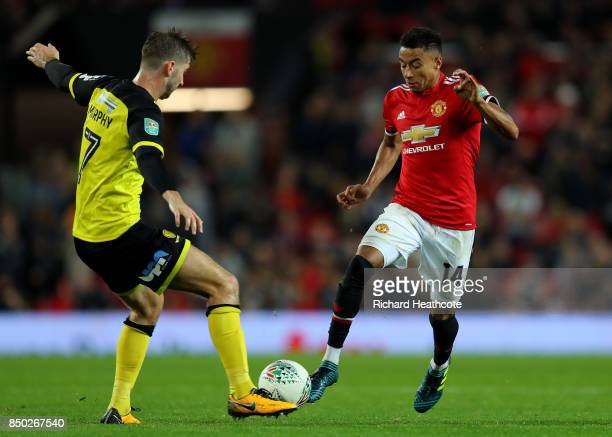 Luke Murphy of Burton Albion and Jesse Lingard of Manchester United battle for possession during the Carabao Cup Third Round match between Manchester...