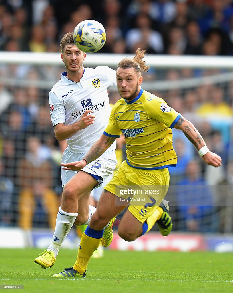Luke Murphy of Leeds United chases Stevie May of Sheffield Wednesday during the Sky Bet Championship match between Leeds United and Sheffield Wednesday at Elland Road on October 4, 2014 in Leeds, England.