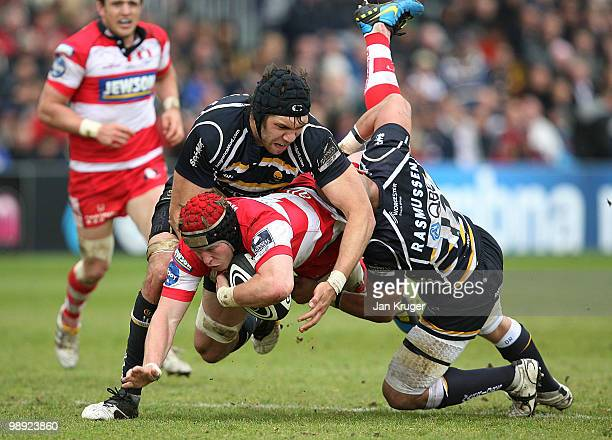 Luke Narraway of Gloucester is upended by Graham Kitchener and Dale Rasmussen of Worcester during the Guinness Premiership match between Worcester...