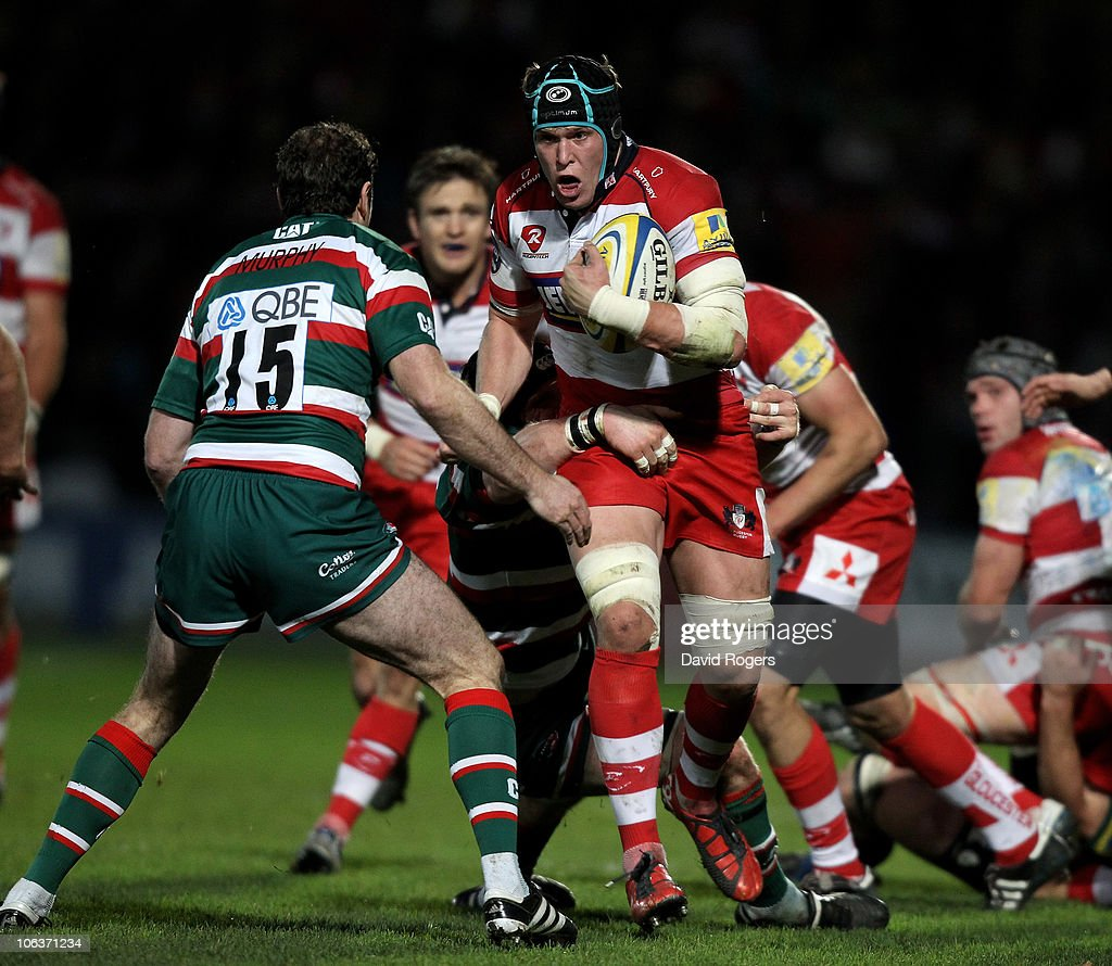 Luke Narraway of Gloucester takes on Geordan Murphy during the Aviva Premiership match between Gloucester and Leicester Tigers at Kingsholm on October 30, 2010 in Gloucester, England.
