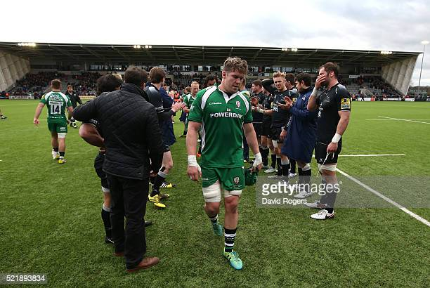 Luke Narraway the London Irish captain leads his team off the pitch after their defeat during the Aviva Premiership match between Newcastle Falcons...