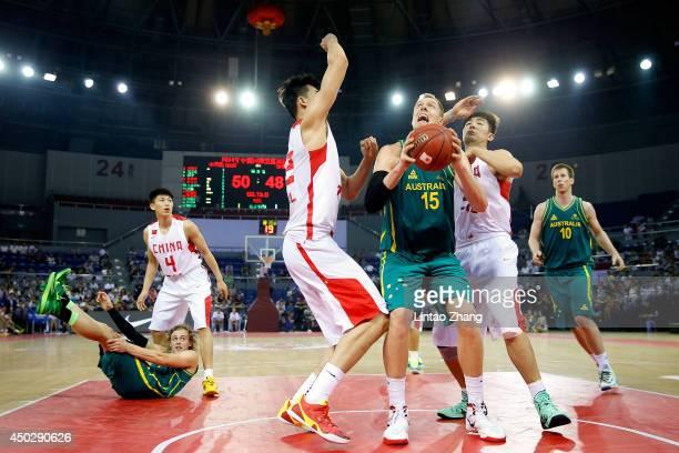 Luke Nevill of Australia drives to the basket against Tao Hanlin of China during the 2014 SinoAustralia Men's International Basketball Challenge...