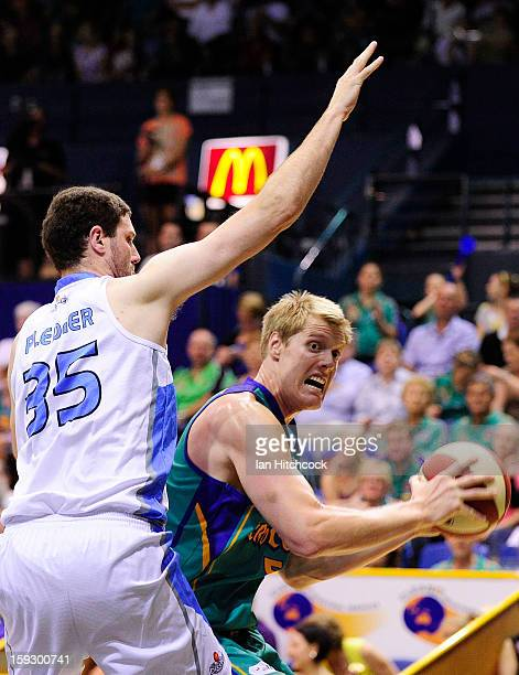 Luke Nevill of Crocodiles looks to get past Alex Pledger of the Breakers during the round 14 NBL match between the Townsville Crocodiles and the New...
