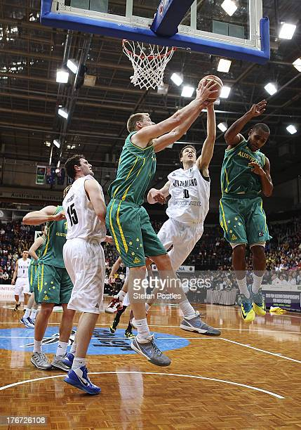 Luke Nevill of the Boomers takes a rebound during the Men's FIBA Oceania Championship match between the Australian Boomers and the New Zealand Tall...