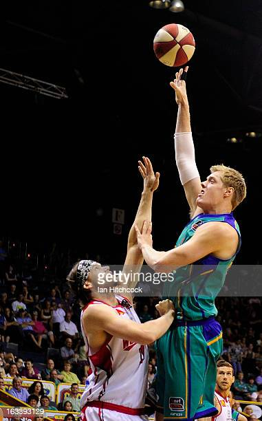 Luke Nevill of the Crocodiles takes a shot over Larry Davidson of the Hawks during the round 22 NBL match between the Townsville Crocodiles and the...
