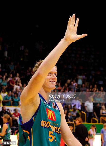 Luke Nevill of the Crocodiles waves to the crowd after winning the round 12 NBL match between the Townsville Crocodiles and the Adelaide 36ers at...