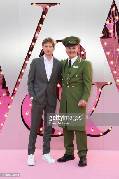 Luke Newberry poses with the Harrods Green Man at the Summer Party at the VA in partnership with Harrods at the Victoria and Albert Museum on June 20...
