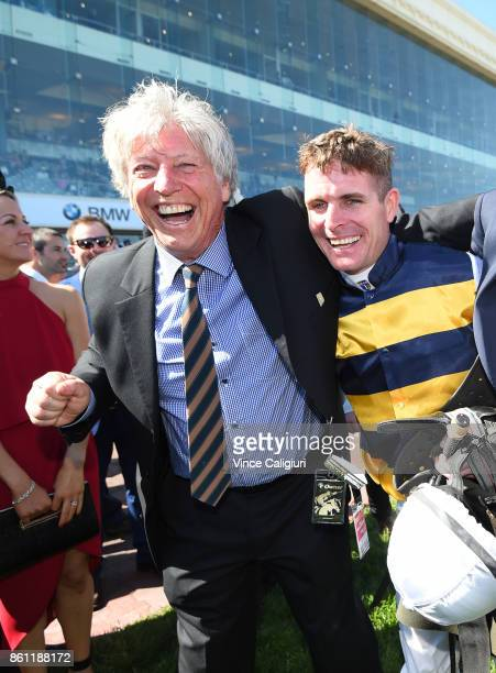 Luke Nolen celebrates with owners after riding Aloisia to win Race 6 Schweppes Thousand Guineas during Melbourne Racing on Caulfield Guineas Day at...
