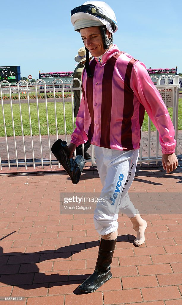 Luke Nolen returns to jockey room after injuring foot after barrier mishap at the barriers in the Maxie Howell Handicap at Caulfield Racecourse on December 26, 2012 in Melbourne, Australia.