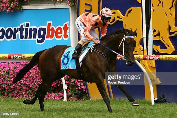 Luke Nolen riding Black Caviar crosses the line to win race Six Sportingbet CF Orr Stakes during CF Orr Stakes Day at Caulfield Racecourse on...