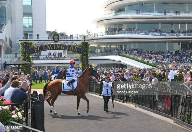 Luke Nolen riding Redkirk Warrior to the the start of Race 6 Seppelt Wines Newmarket Handicap during Melbourne Racing at Flemington Racecourse on...
