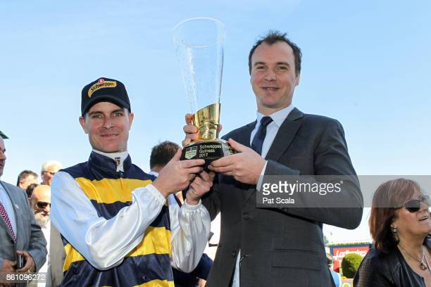 Luke Nolen with Aaron Purcell after Aloisia won the Schweppes Thousand Guineas at Caulfield Racecourse on October 14 2017 in Caulfield Australia