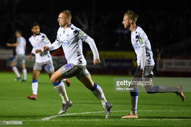 Luke Norris of Colchester United celebrates after scoring his team's first goal during the Carabao Cup Round of 16 match between Crawley Town FC and...