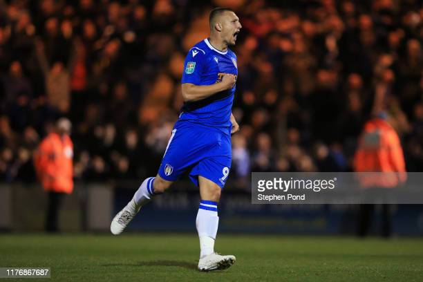 Luke Norris of Colchester United celebrates scoring his team's first penalty in the penalty shoot out during the Carabao Cup Third Round match...