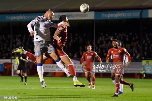 Luke Norris of Colchester United scores his team's first goal past Tom Dallison of Crawley Town during the Carabao Cup Round of 16 match between...