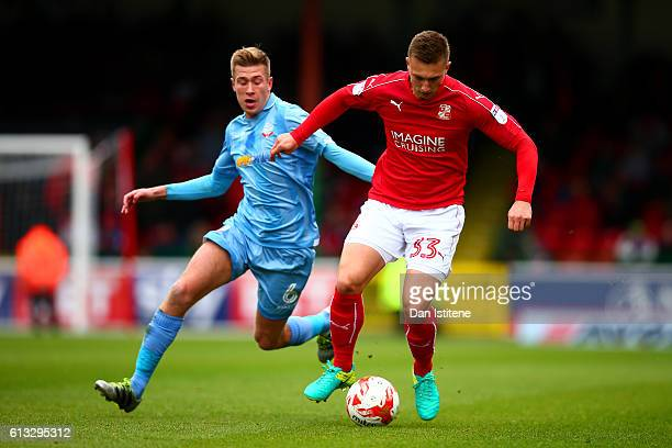 Luke Norris of Swindon Town battles for the ball with Josh Vela of Bolton Wanderers during the Sky Bet League One match between Swindon Town and...