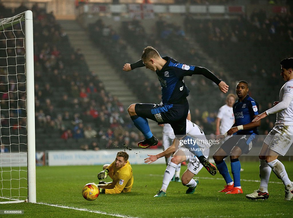 Luke Norris of Swindon Town scores his team's first goal during the Sky Bet League One match between Milton Keynes Dons and Swindon Town at StadiumMK on December 30, 2016 in Milton Keynes, England.