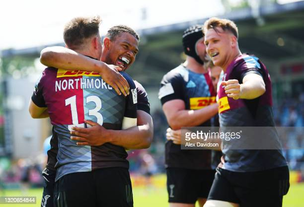 Luke Northmore of Harlequins celebrates with Nathan Earle after scoring his side's fourth try during the Gallagher Premiership Rugby match between...