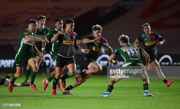 Luke Northmore of Harlequins goes into contact with Ollie Hassell-Collins of London Irishduring the Gallagher Premiership Rugby match between London...
