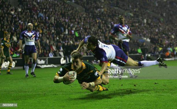Luke O'Donnell of Australia goes over only for the try to be dissallowed for a forward pass as Paul Wellens of Britain challenges during the Gillette...