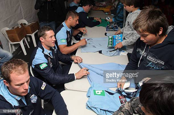 Luke O'Donnell of the NSW Blues signs autgraphs for fans during a visit to Lennox Head the site of last week's tornado on June 10 2010 in Byron Bay...