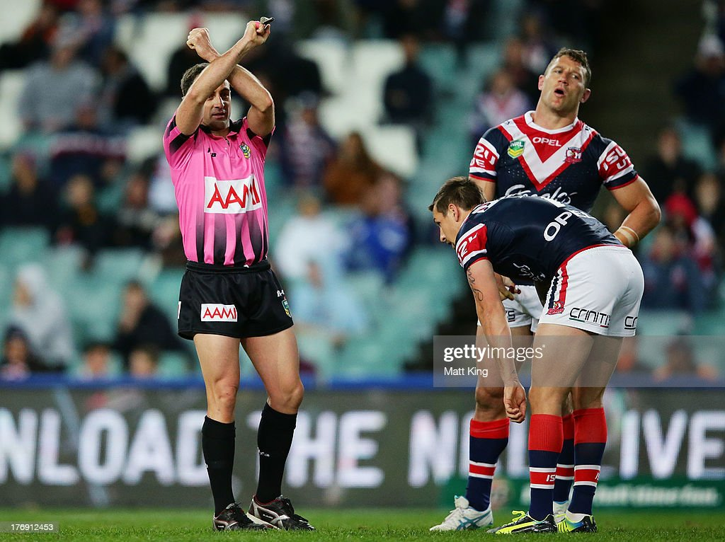 Luke O'Donnell of the Roosters is put on report for a dangerous tackle during the round 23 NRL match between the Wests Tigers and the Sydney Roosters at Allianz Stadium on August 19, 2013 in Sydney, Australia.