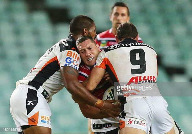 Luke O'Donnell of the Roosters is tackled during the NRL trial match between the Sydney Roosters and the Wests Tigers at Allianz Stadium on February...