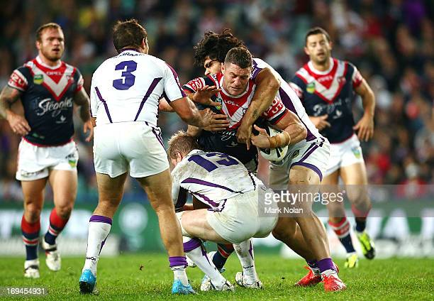 Luke O'Donnell of the Roosters is tackled during the round 11 NRL match between the Sydney Roosters and the Melbourne Storm at Allianz Stadium on May...