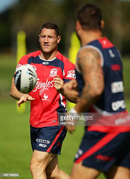 Luke O'Donnell passes during a Sydney Roosters NRL training session at Kippax Lake on May 7 2013 in Sydney Australia