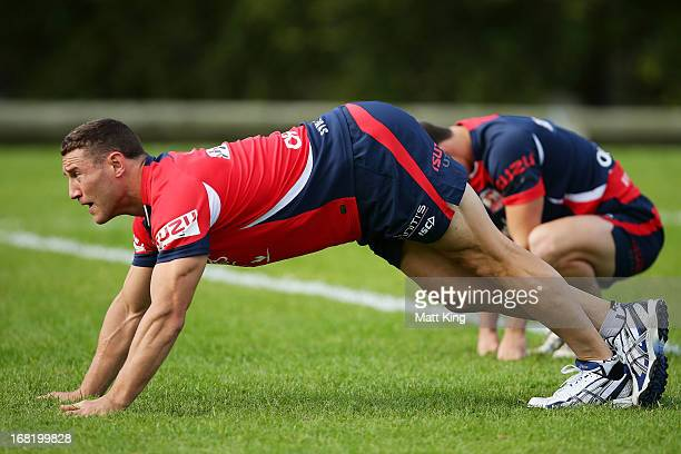 Luke O'Donnell stretches during a Sydney Roosters NRL training session at Kippax Lake on May 7 2013 in Sydney Australia