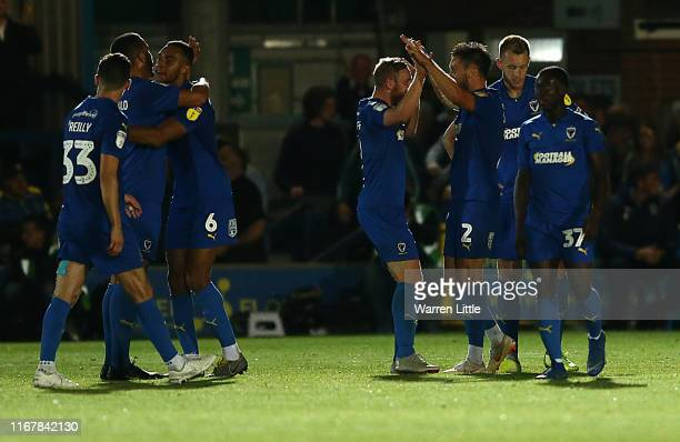 Luke O'Neill of AFC Wimbledon is congratulated after scoring the equalising goal during the Carabao Cup First Round match between AFC Wimbledon and...