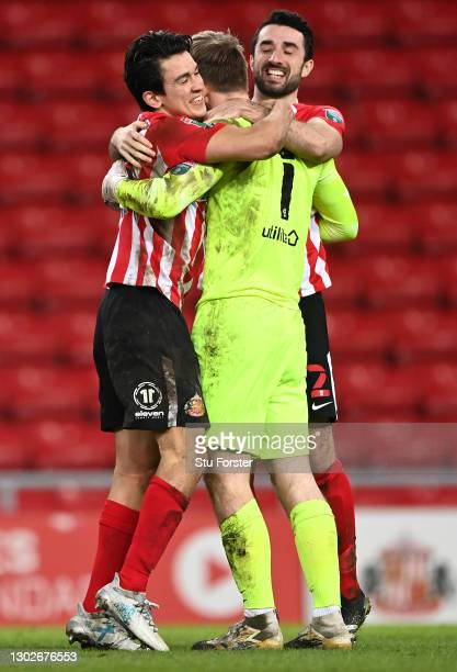 Luke O'Nien and Conor McLaughlin congratulate Lee Burge of Sunderland after their side win the penalty shoot out during the Papa John's Trophy...