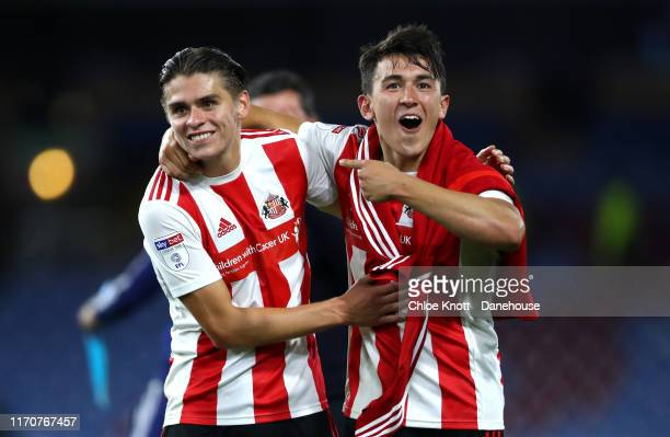 Luke O'Nien and George Dobson of Sunderland AFC celebrate winning the Carabao Cup Second Round match between Burnley FC and Sunderland AFC at Turf...