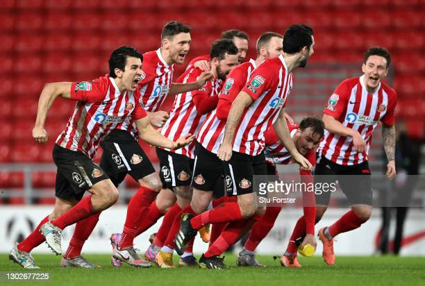 Luke O'Nien of Sunderland and team mates celebrate the penalty shoot out win after the Papa John's Trophy Semi-Final match between Sunderland and...