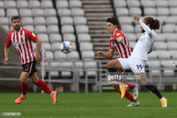 Luke O'Nien of Sunderland is challenged by Marcus Harness of Portsmouth during the Sky Bet League 1 match between Sunderland and Portsmouth at the...