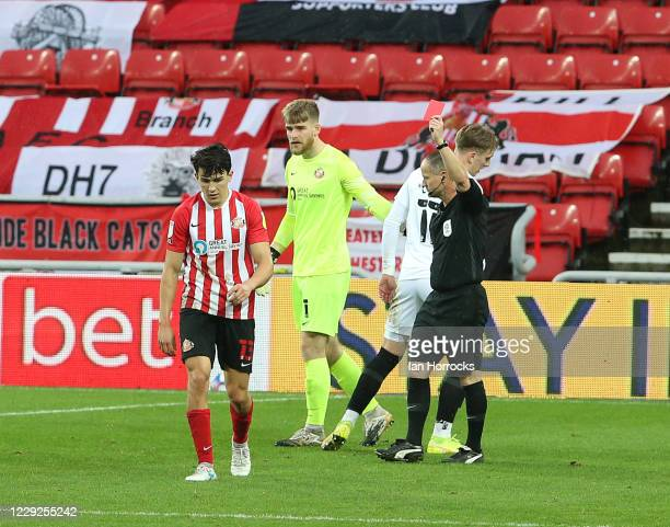 Luke O'Nien of Sunderland is sent off after giving away a penalty during the Sky Bet League One match between Sunderland and Portsmouth at Stadium of...